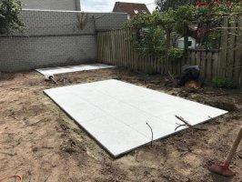 Aanleg natuursteen tegels / gazon Helmond